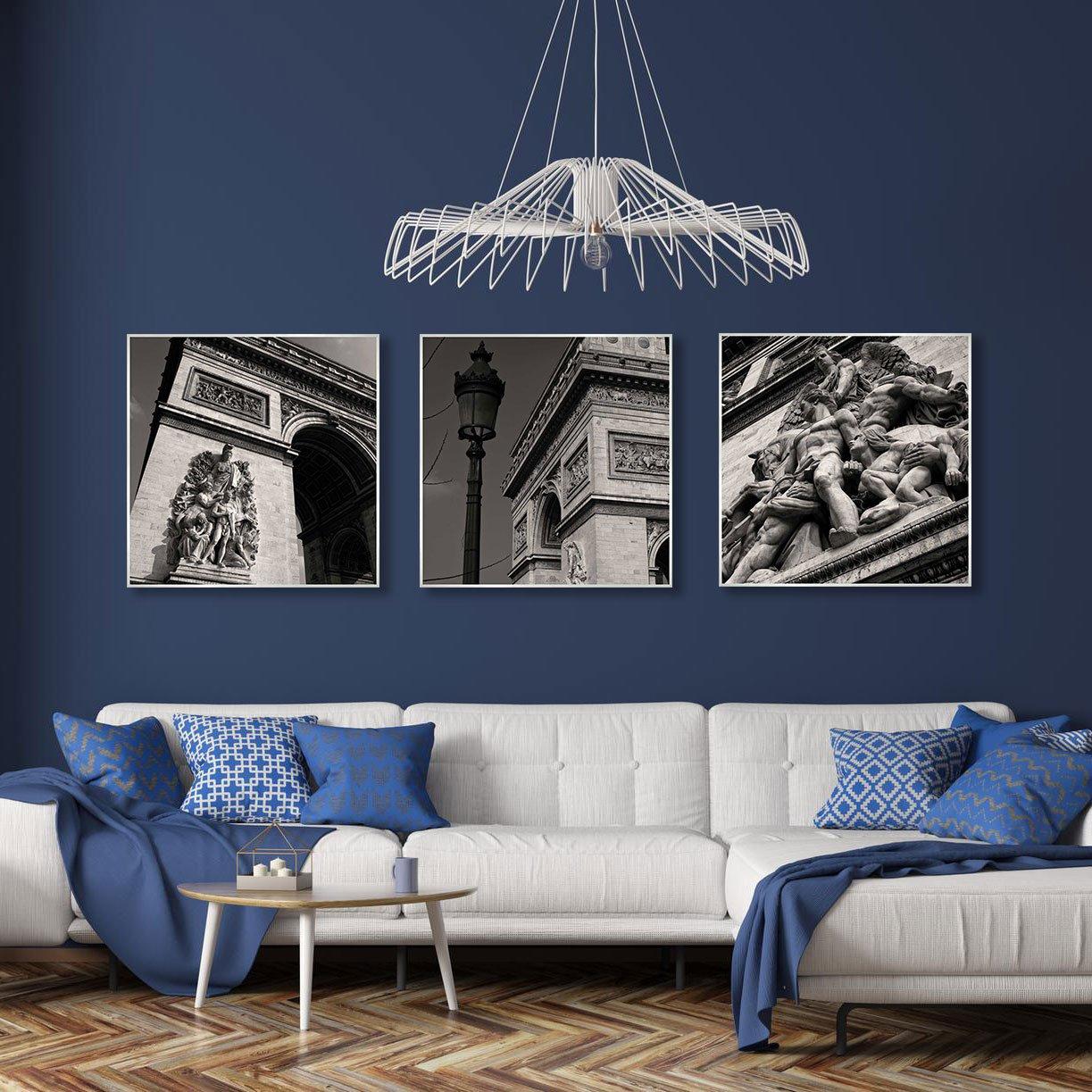 Exemplo de decoração com trio de quadros Dorival Moreira.